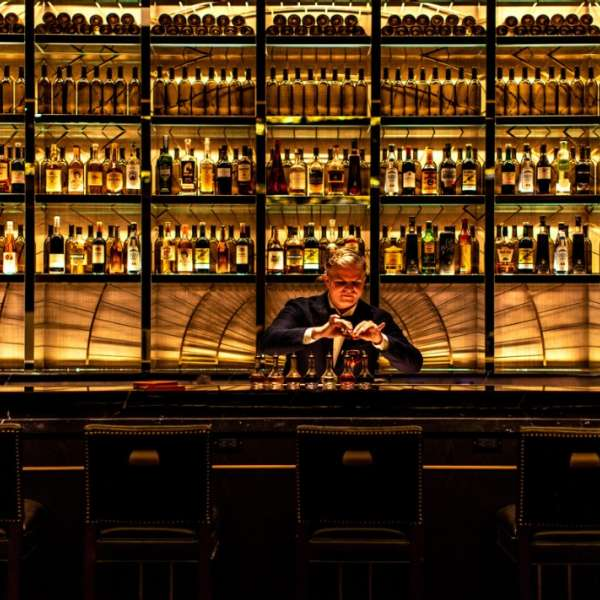 NoMad Bar with bartender.