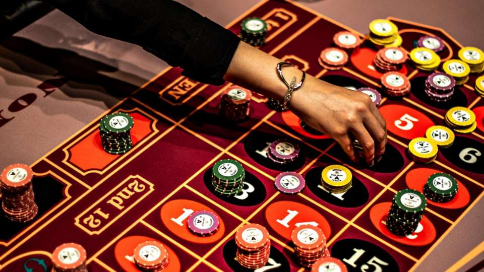 A Roulette table game with chips.