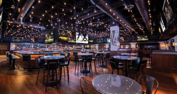 View of the main seating area inside BetMGM Sportsbook & Bar.
