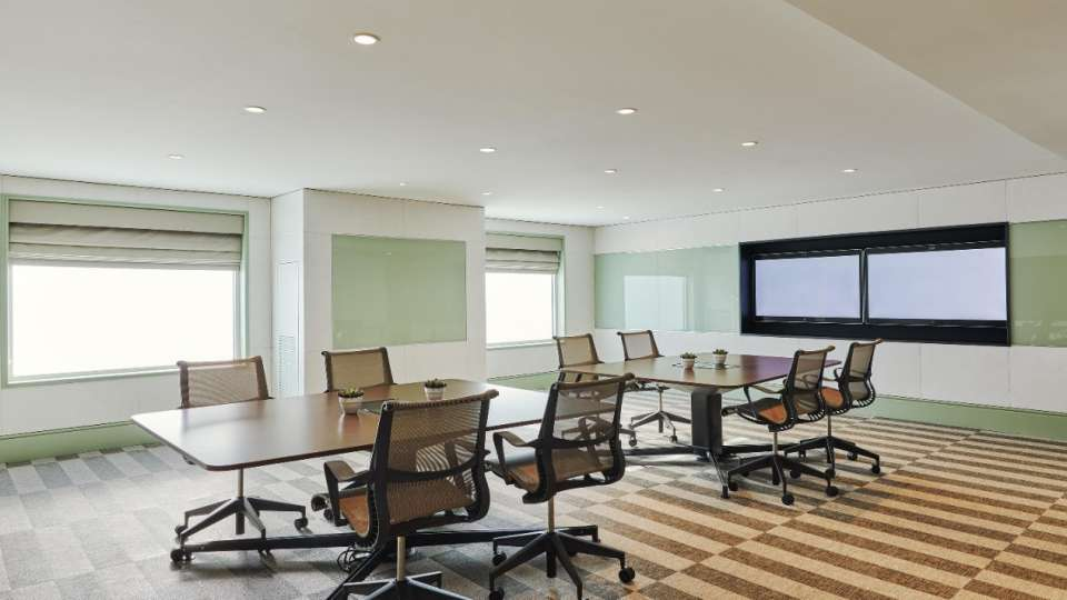 Conference room with screens in Ideation Studio.