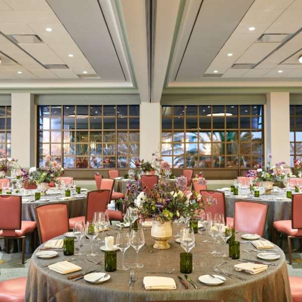 Multiple tables in the Griffith meeting space with a banquet style set-up at Park MGM.