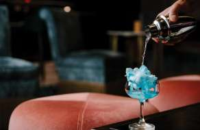 A cotton candy cocktail on a table at Juniper Cocktail Lounge.