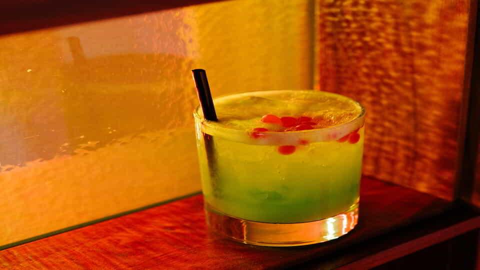 Closeup of a specialty cocktail featured at On the Record.
