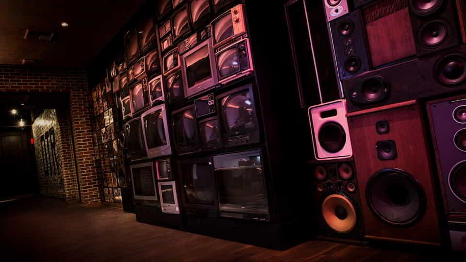 Wall décor using old school stereos.