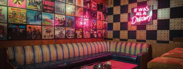 View of a karoke room in On The Record.