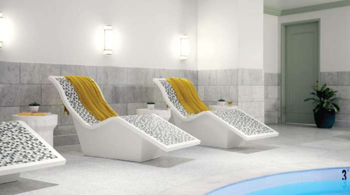 Lounge chairs near the hot tub at the Park MGM Spa.