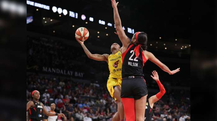 The Las Vegas aces A'ja Wilson defending a basket.