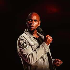 Promotional image for Dave Chappelle and Friends and Grand Garden Arena.