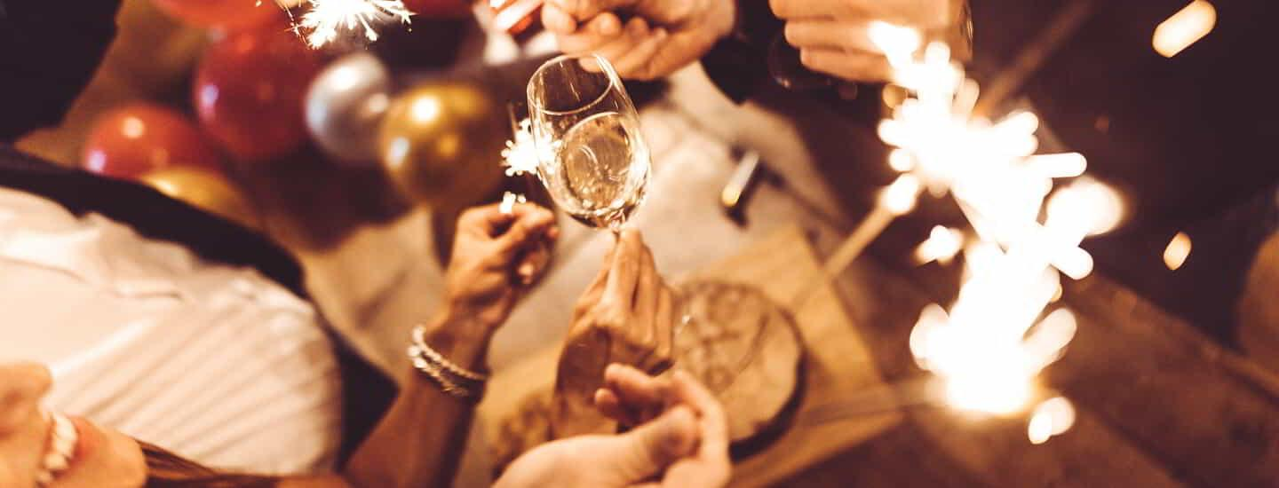 Friends toasting at the party for the new years eve.