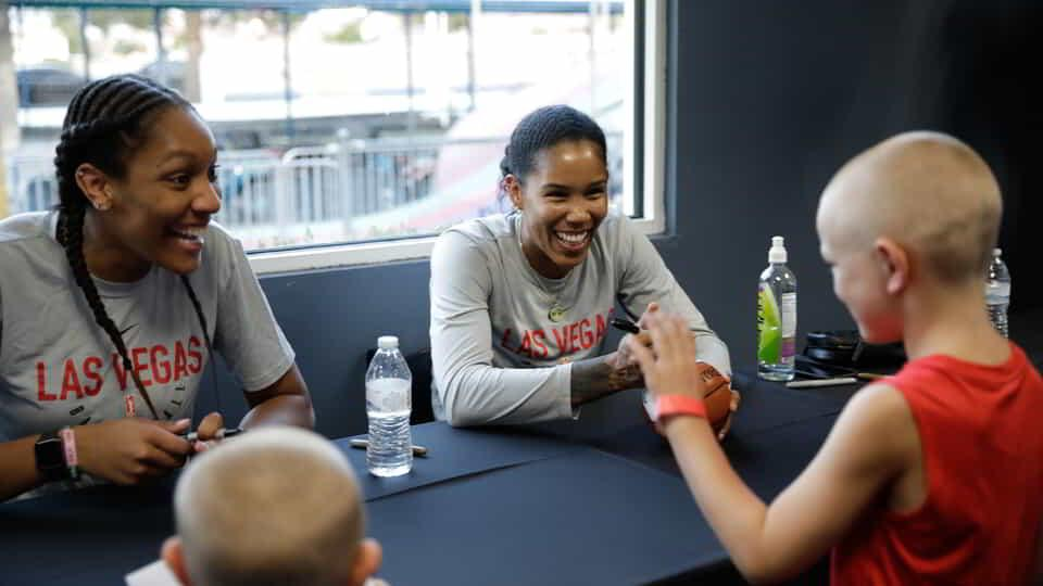 Las Vegas Aces players in the community.