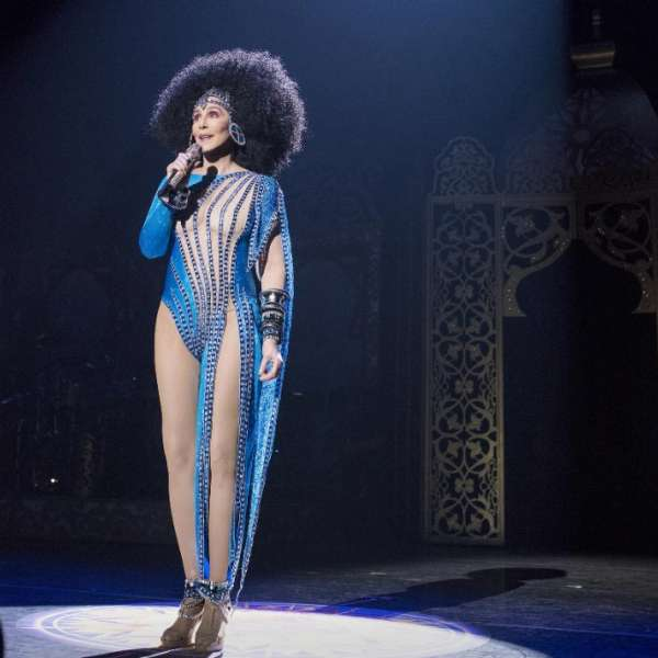 Cher performing solo with blue gem outfit.