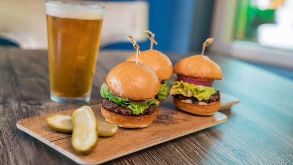 Sliders with Beer on the dining table.