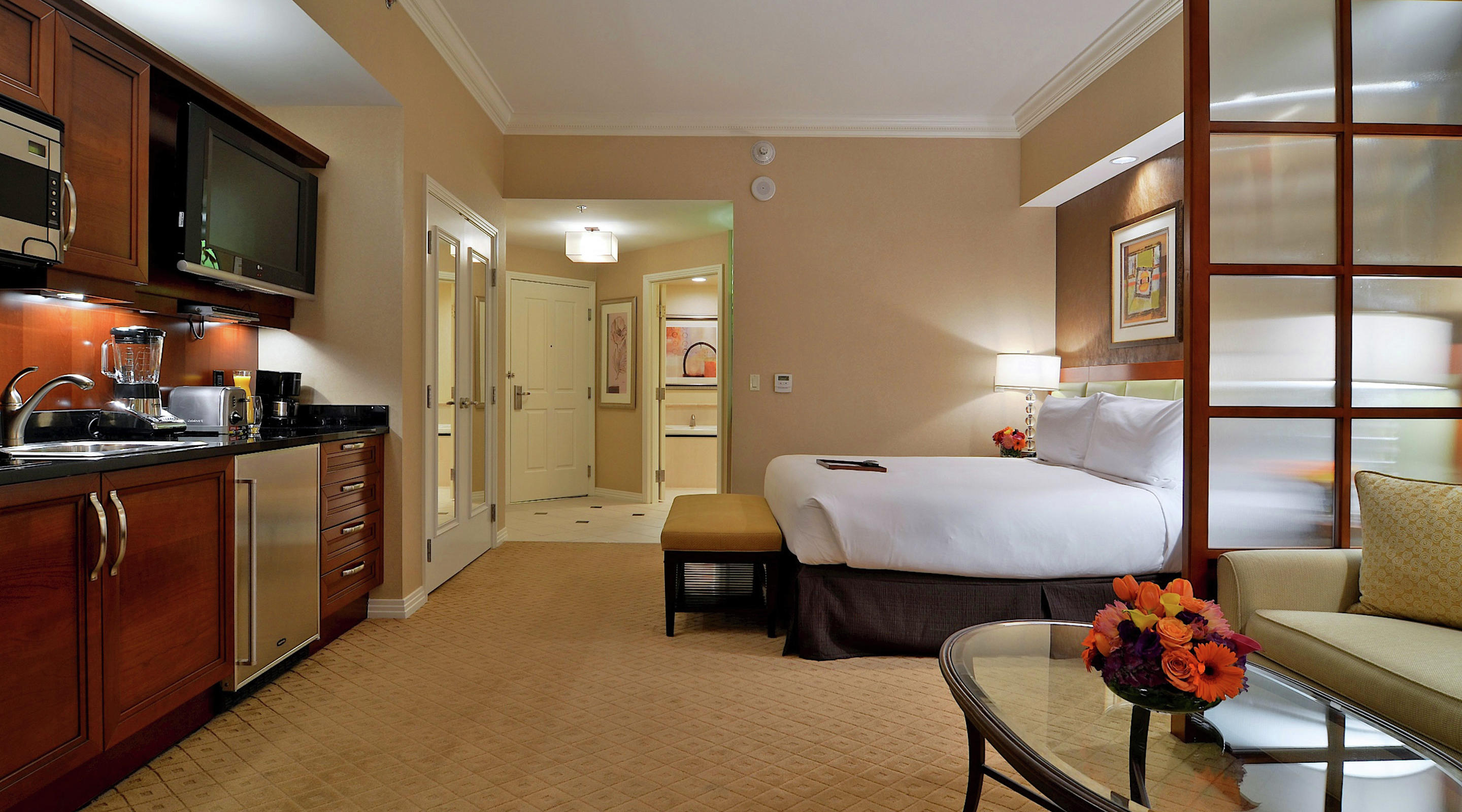 Signature Balcony Deluxe Suite with View Bedroom & Kitchenette