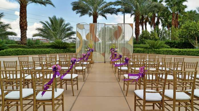 Signature Outdoor Wedding Seating with Palm Trees in the Background