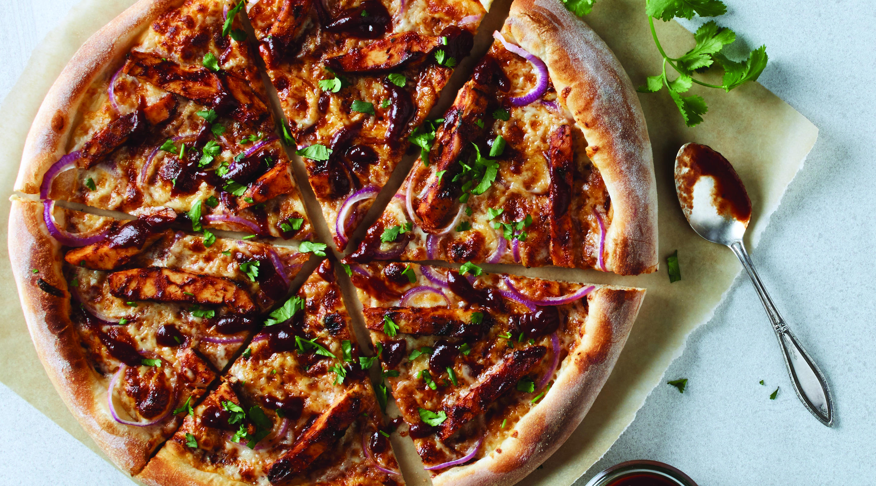 Created here in 1985. Our legendary BBQ Chicken Pizza sauce, smoked Gouda, red onions and fresh cilantro transform this original to iconic.