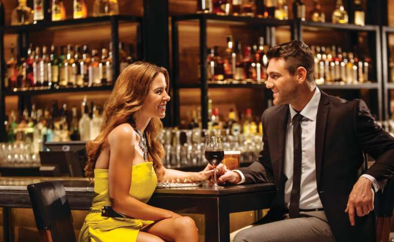 Two people sitting at the bar.