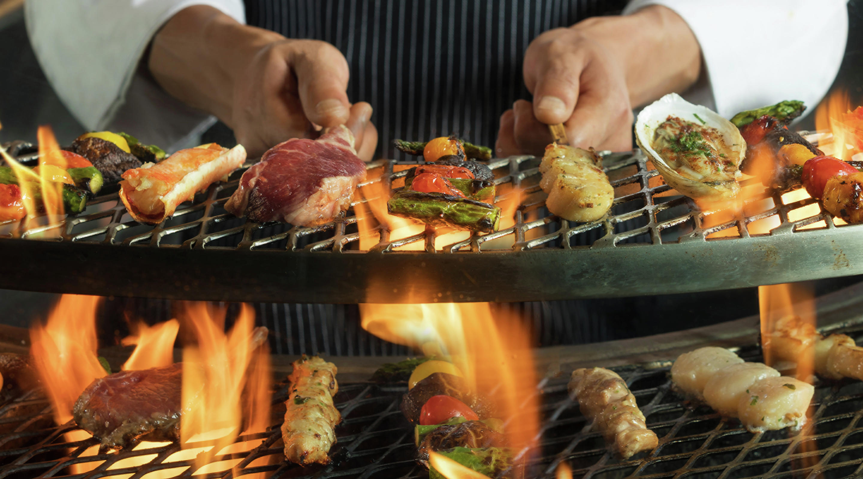 Chef hands on grill.
