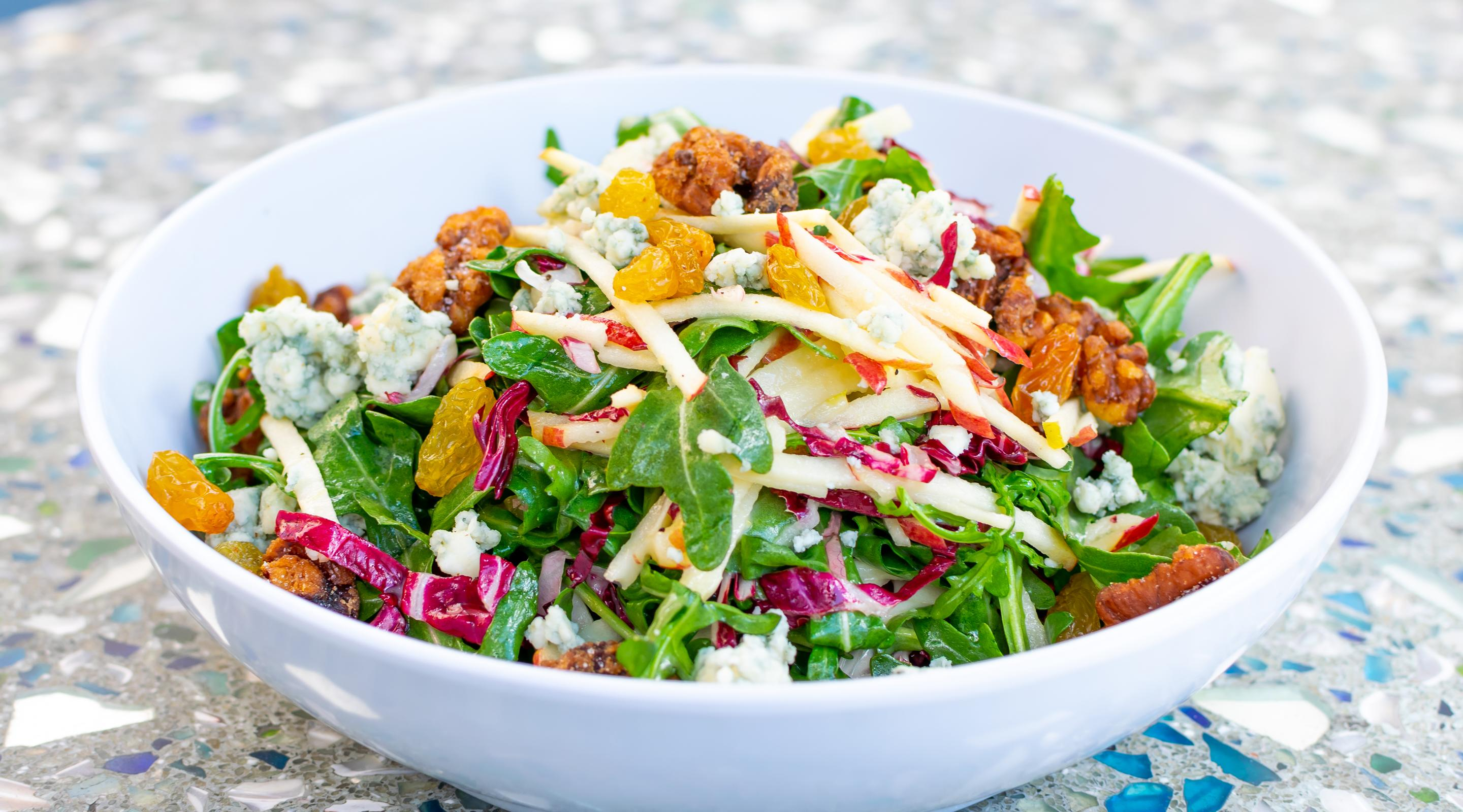 Enjoy a classic Arugula & Apple salad next to The Mirage pool for a truly unforgettable experience.