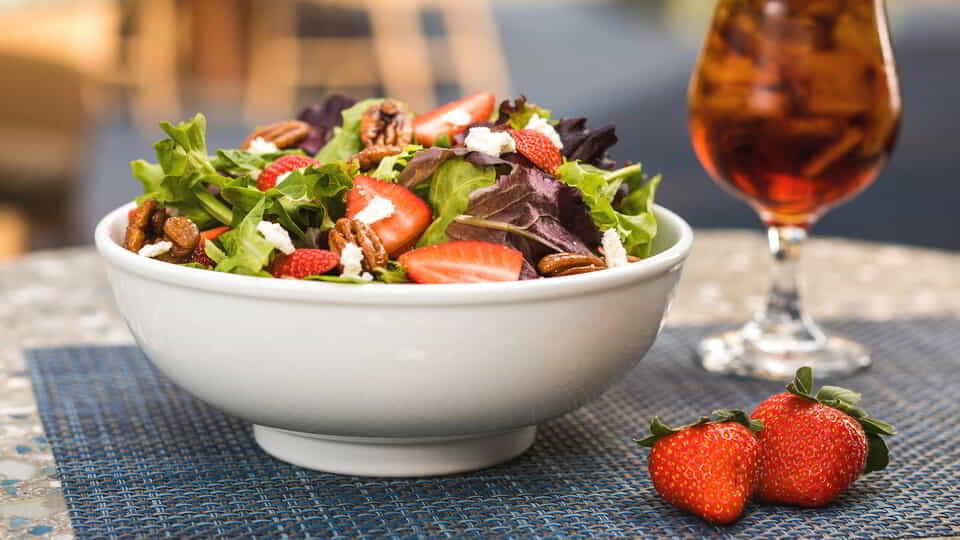 Enjoy a classic Strawberry Feta Salad next to The Mirage pool for a truly unforgettable experience.