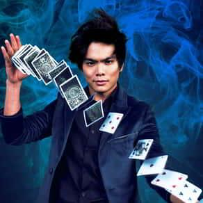 Shin Lim springing cards from one hand to another.