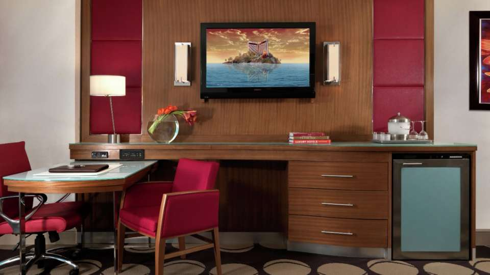 Entertainment center with TV and minibar in The Mirage resort rooms