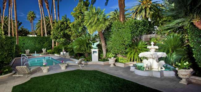 mirage-villas-backyard-landscaping-exterior-night.tif.image.650.300.high