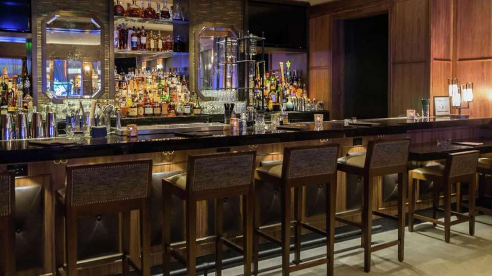 An intimate piano lounge serving lively libations and sophisticated sounds.