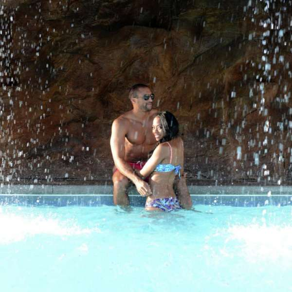 mirage-pool-lifestyle-genx-couple-under-waterfall