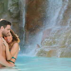 mirage-pool-lifestyle-genx-couple-waterfall-hug.tif.image.300.300.high