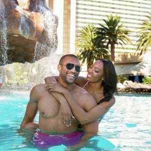 Couple by the waterfall in The Mirage pool