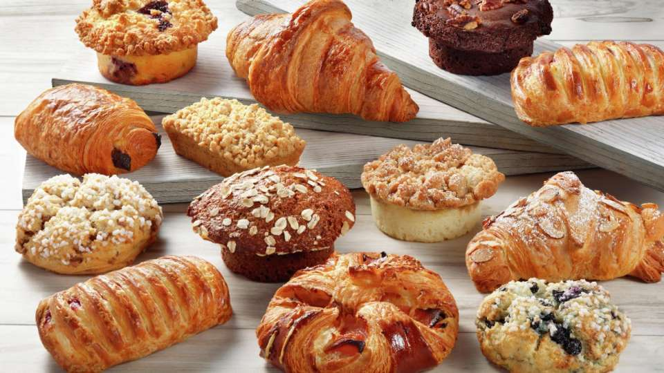 This modern café features a various selection of freshly baked pastries that are paired perfectly with your morning coffee.