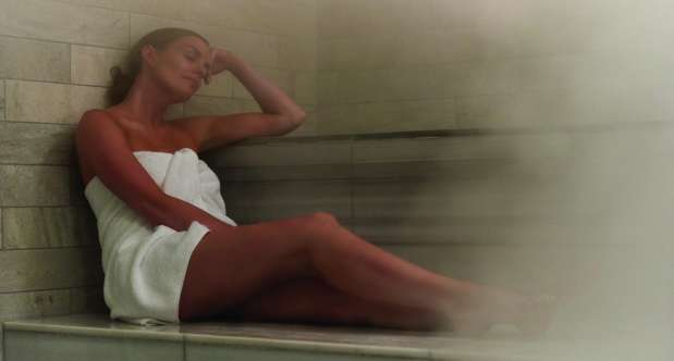 Woman relaxing in the sauna at ESPA.
