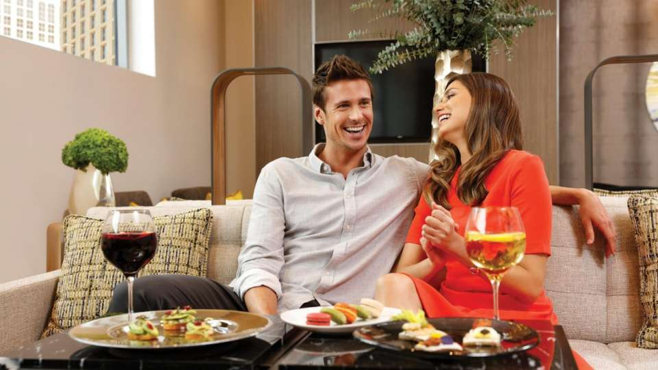 A couple is enjoying conversations while dining at Vdara Club Lounge.