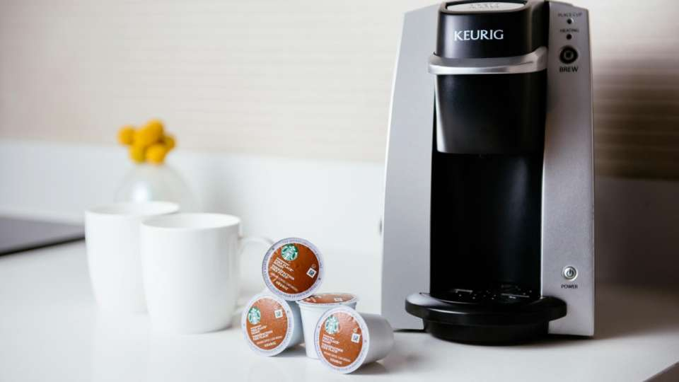 Keurig coffee machine in a hotel room.