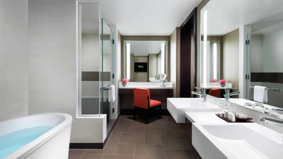 Dual vanities and a spa-style soaking tub complement our Two Bedroom Hospitality Suite.