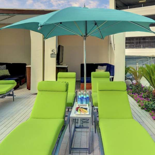 The Access Cabana features a centralized location, designated chaise lounge chairs and comes complete with refreshments.