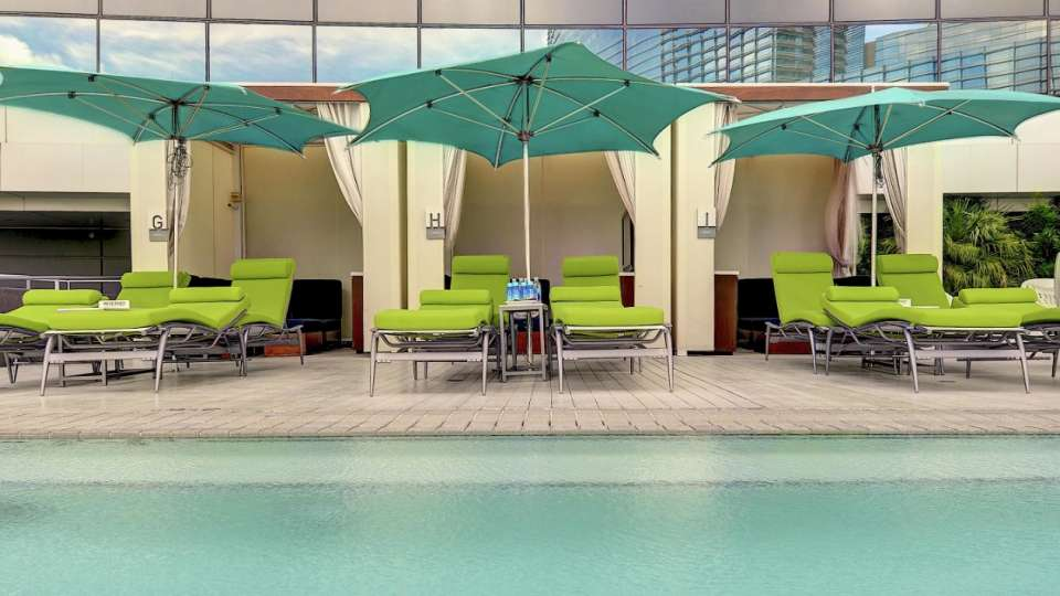Surrounded by cutting-edge design an Access Cabana features a semi-private plunge pool, designated chaise lounge chairs, and comes complete with refreshments.