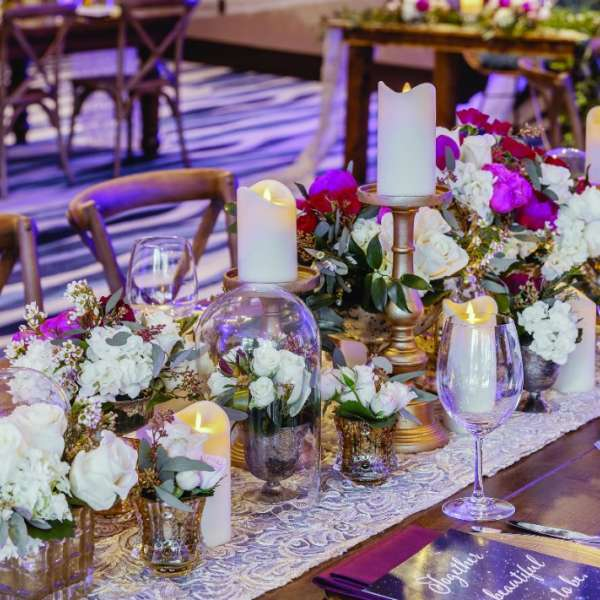 Table with flowers at a wedding reception venue at Vdara.