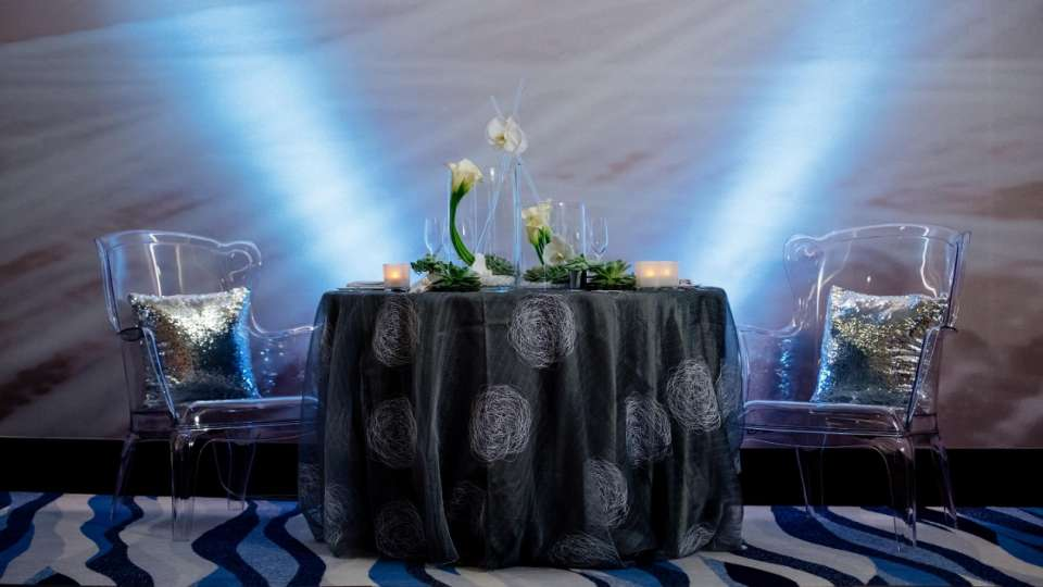 Elevate your wedding reception with this modern and sophisticated sweetheart table set-up in Vdara's Silk Road.